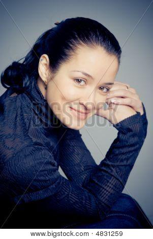 Studio Portrait Of Smiling Beautiful Woman