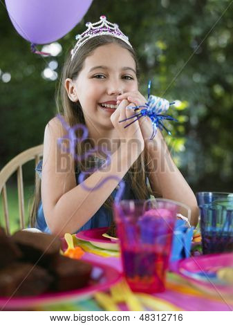 Portrait of a young girl at the outdoor birthday party