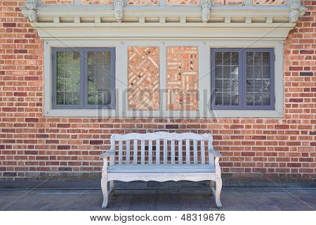 House Brick Exterior With Wood Bench