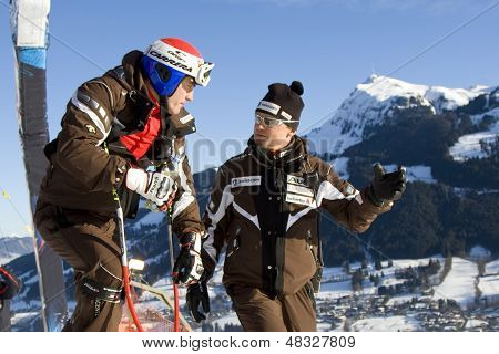 KITZBUHEL TIROL, AUSTRIA - JAN 24 2009; Kitzbuhel Tirol Austria, Tobias Gruenenfelder (SUI) and Swiss team coach at the Hahnenkamm race  the men's downhill ski race part of the Audi FIS Alpine Ski  World cup.