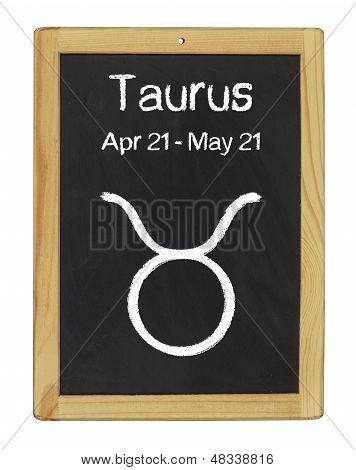 the zodiac sign Taurus on a blackboard