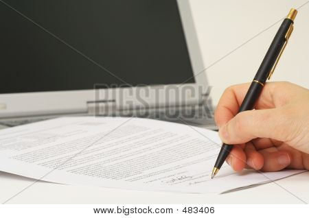 Signing Contract - Signing A Contract With Laptop In Background