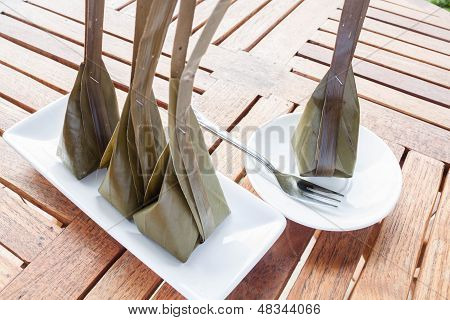 Steamed Flour With Coconut Filling On Wooden Table