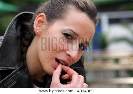 Girl Eating Nut