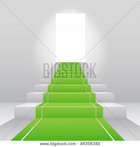 Stairs with green velvet carpet.