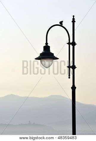 Streetlamp over castle ruins