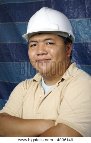 Smiling Asian Contractor At Worksite