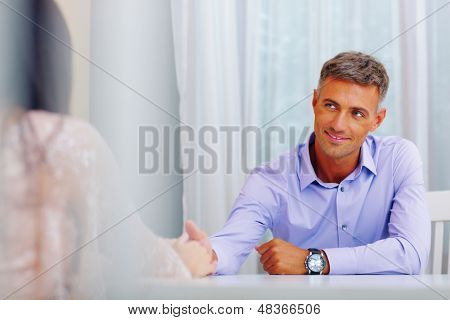 Portrait of a young man holding a hand of his beloved woman