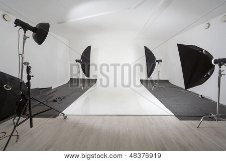 Studio with photographic equipment and a white backdrop
