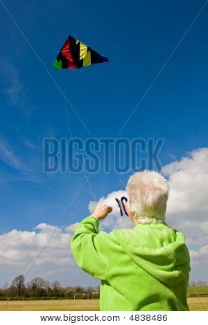 Elderly Woman Flying A Kite