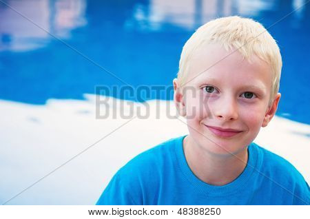 Portrait Of Young Smiling Boy At The Pool
