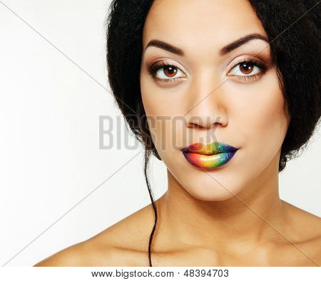 Beauty portrait of beautiful young mulatto fresh woman with rainbow lipstick, detail of face and shoulders closeup