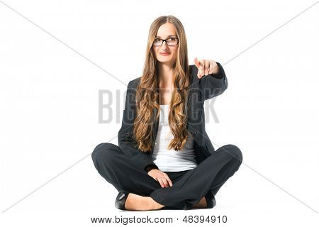 Young woman in front of white background, sitting on the floor, maybe she is a businesswoman or laywer