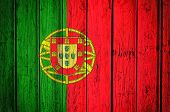 Portugal flag on the old wooden background poster