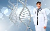 Image of DNA strand against colour background poster