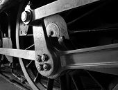 Close up of the wheels on a steam locomotive poster