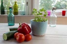 Vegetables, mint pot and old bottles.