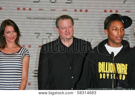 Cameron Diaz with Al Gore and Pharrell Williams at a press conference to Announce the Global Climate Crisis Campaign Concert