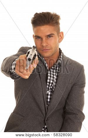 Serious Man In Suit Pointing A Revolver