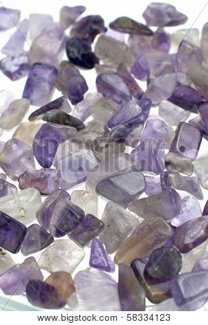 Amethyst gravel necklace and bracelet beads background isolated on white background. poster
