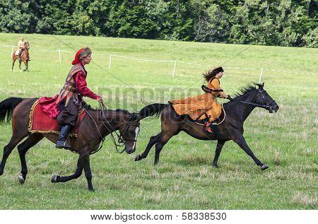 History Fans Dressed As 17Th Century Polish Gentry Ride On Horseback