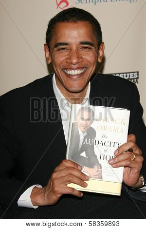 Barack Obama signing copies of his book