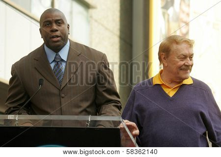 Magic Johnson and Jerry Buss at the Ceremony Honoring Los Angeles Lakers Owner Jerry Buss with the 2,323rd star on the Hollywood Walk of Fame. Hollywood Boulevard, Hollywood, CA. 10-30-06