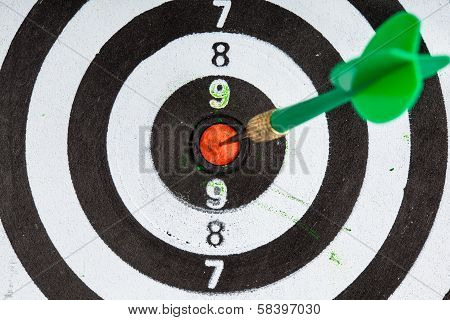 Bullseye. Black And White Target With Dart As Sport Background
