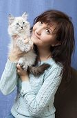 Charming young woman with sibirsky nevsky kitten poster