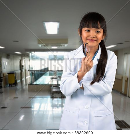 Young asian girl dressup as a doctor standing in hospital
