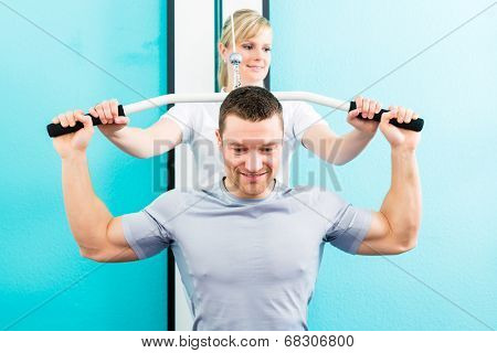 Patient at the physiotherapy doing physical exercises with therapist in sport rehabilitation
