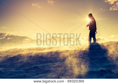 Hiker standing on top of a mountain. Dramatic scenery. Carpathian, Ukraine, Europe. Beauty world.