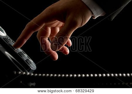 Hand Of A Businessman Dialing Or Initiating A Call