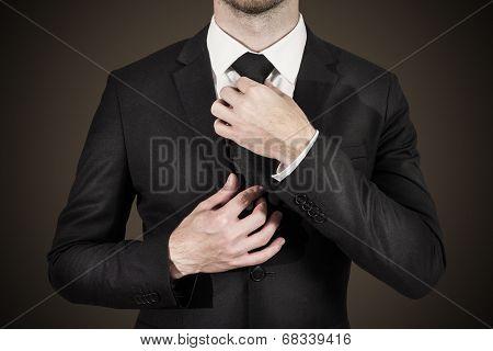 Businessman Correcting Tie Fashion