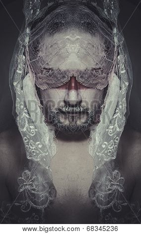 duality veiled mystery man in the face and red painted mask