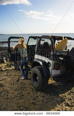 Woman With Suv At The Beach