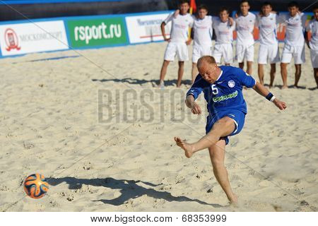 MOSCOW, RUSSIA - JULY 13, 2014: A. Aniko of Estonia performs penalty shoot-out in the match with Kazakhstan during Moscow stage of Euro Beach Soccer League. Kazakhstan won 3:2 after penalty shoot-out
