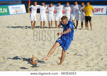 MOSCOW, RUSSIA - JULY 13, 2014: Ragnar Rump, Estonia performs penalty shoot-out in the match with Kazakhstan during Moscow stage of Euro Beach Soccer League. Kazakhstan won 3:2 after penalty shoot-out