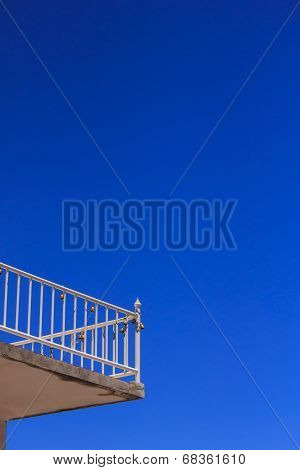 View Of The Blue Sky From A Hotel Balcony