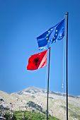 Albanian and EU Flags on the Gjirokaster Castle, Albania. poster