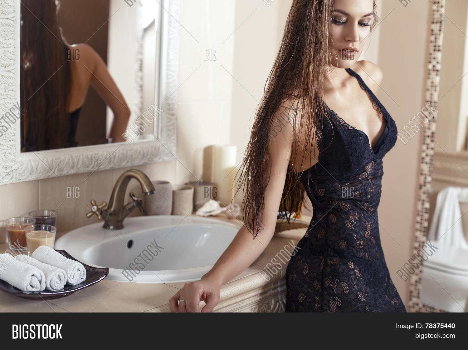3964f89ed27 sexy woman with long dark hair wearing lace lingerie dress posing in luxury  bathroom