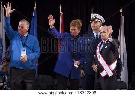 NEW YORK - NOV 11, 2014: Grand Marshall Raymond Kelly, former NYC Police Commissioner and USMC Vietnam War veteran, and others on stage wave to marchers in the 2014 America's Parade on Veterans Day.