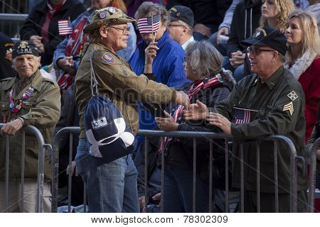 NEW YORK - NOV 11, 2014: Two US vets shake hands during the 2014 America's Parade held on Veterans Day in New York City on November 11, 2014.