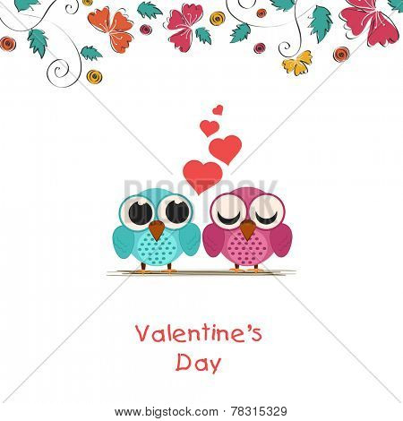 Happy Valentine's Day celebration concept with cute owls couple in love and red hearts.
