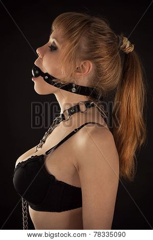 profile of woman face slave gagged