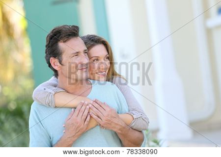 Middle-aged couple looking towards the future