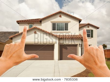 Female Hands Framing Beautiful House
