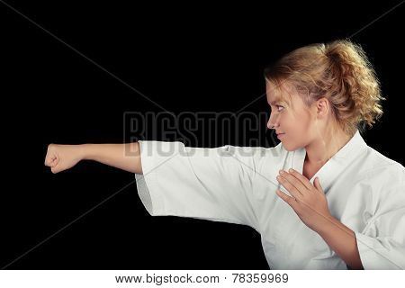 Profile of a Young Karate Woman Wearing Kimono in Martial Art Pose
