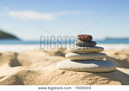 Pebbles In Sand