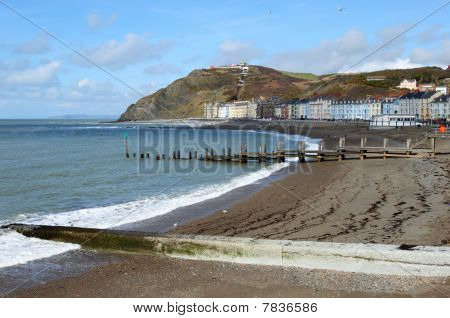 Aberystwyth seaside town North beach in Wales UK. poster
